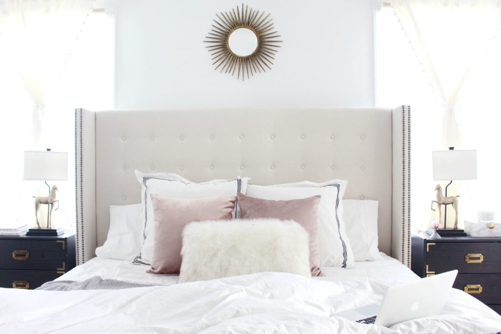 A master bedroom pillow and throw update for spring.