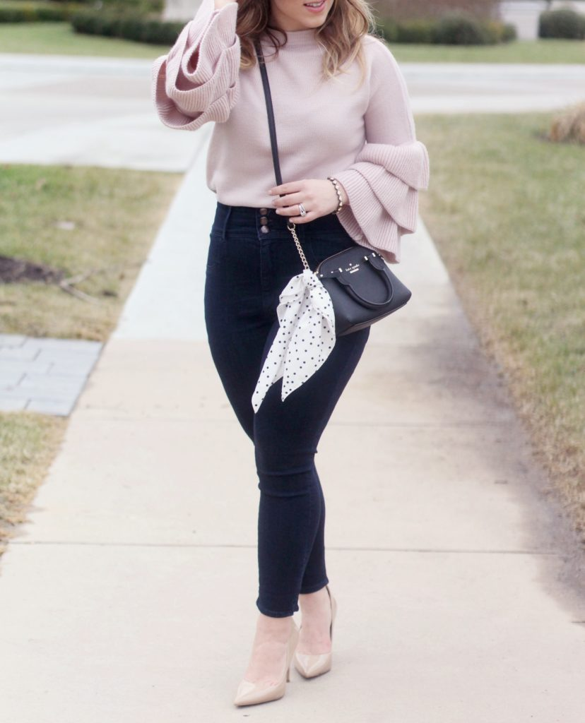 Zoe With Love wears a ruffle sleeve sweater and dishes on what she thinks about this current fashion trend.