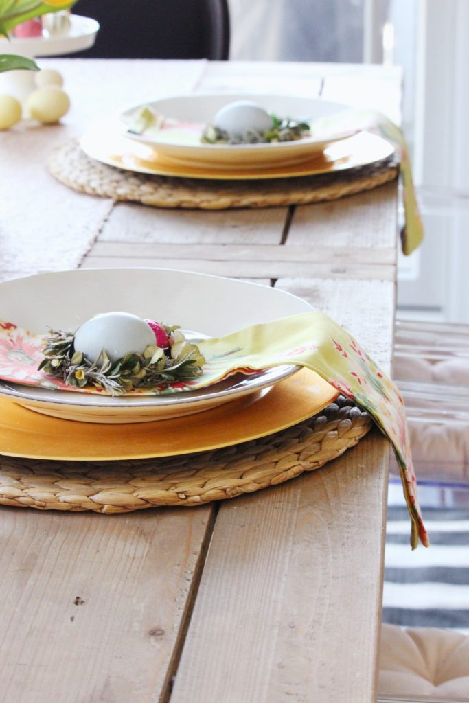Easter place setting. Zoe With Love shares how to create an easy tulip centerpiece for your Easter table. Natural dyed eggs, floral napkins and chocolates complete the look.